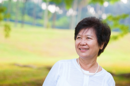 60s Asian senior woman at park in a morning photo