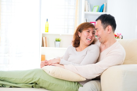 happy asian couple: Happy Asian couple having fun time at home