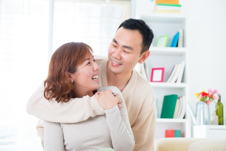 Happy Asian couple lifestyle, indoor home photo