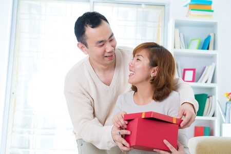 Asian young Man handing over love gift to young woman photo