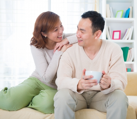 Asian couple having conversation at home photo