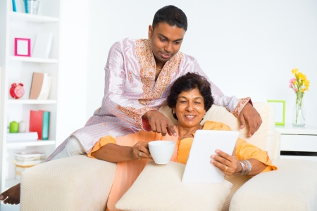 Indian family using digital computer tablet at home Stock Photo - 16753119
