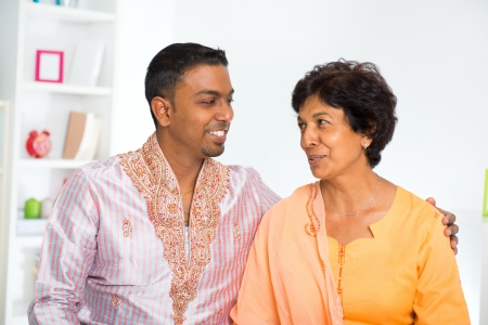 Indian mature mother talking with her adult son at home photo