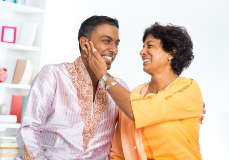 the elderly residence: Happy mature Indian woman with her adult son Stock Photo