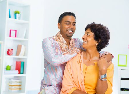 Asian Indian family, adult son having conversation with senior mother indoor. Stock Photo - 16753179