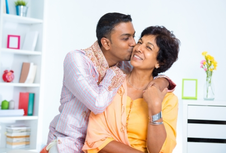 Indian male kissing his mother, living lifestyle at home photo