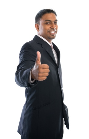 Excited thumb up 30s Indian businessman in black suit isolated on white background photo