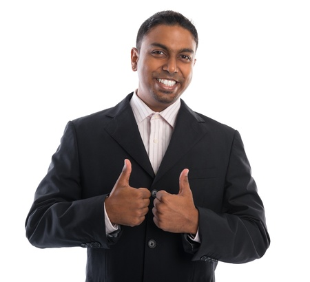 good news: Thumbs up 30s Indian businessman giving thumbs up over white background Stock Photo