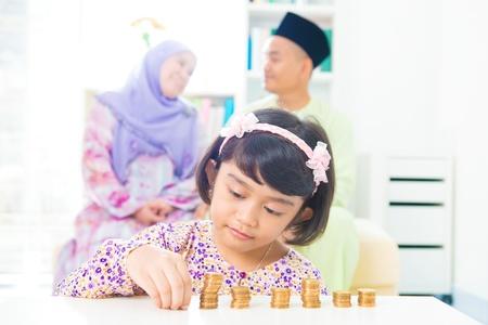 Southeast Asian girl money savings concept. Asian family living lifestyle. Imagens