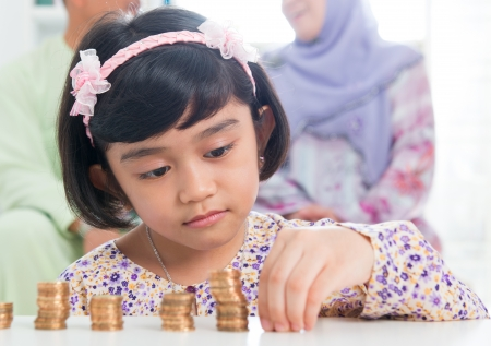 counting: Muslim banking concept. Southeast Asian saving money at home, asian family living lifestyle.