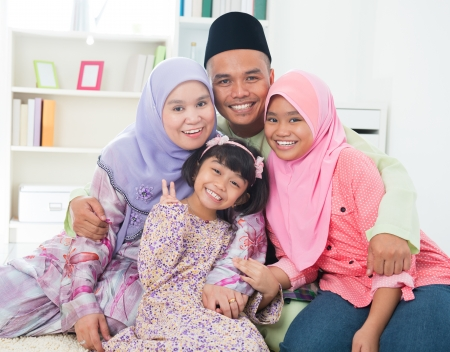 Southeast Asian family quality time at home. Muslim family living lifestyle. photo