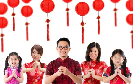 traditional celebrations: Group of Chinese people greeting, Chinese new year concept, isolated over white background.