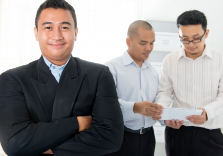 Southeast Asian business men in office photo