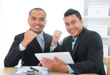 malaysian people: Southeast businessteam achievement concept, indoor office