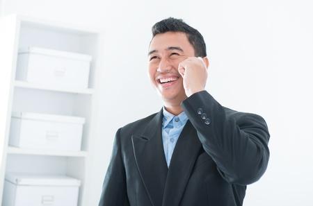 Southeast Asian business man on smartphone communication photo