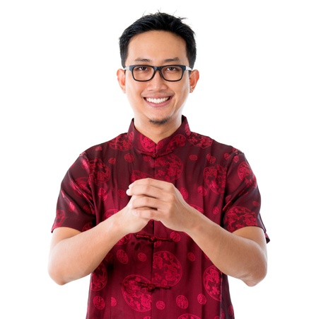 east asian culture: China man in traditional Chinese Tang suit greeting, isolated on white background  Stock Photo
