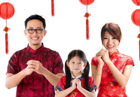 cheongsam: Chinese family greeting, Chinese new year concept, isolated over white background.