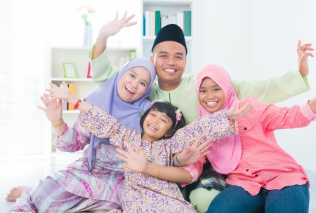 eastern asian: Excited Southeast Asian family at home. Muslim family living lifestyle.