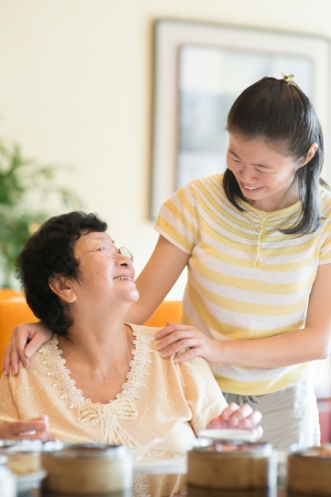 healthy seniors: Asian Chinese family interaction inside a restaurant Stock Photo