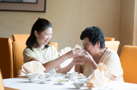 southeast: Southeast Asian Chinese family having meal in restaurant Stock Photo