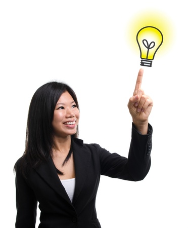 Southeast Asian woman hand pointing at  light bulb idea over white background photo