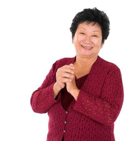 personas saludandose: Feliz Año Nuevo Chino. Saludo chino mujer mayor, aisladas sobre fondo blanco