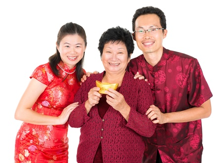 chinese family: Happy Chinese New Year. Asian Chinese family greeting, holding a gold ingot isolated on white background Stock Photo