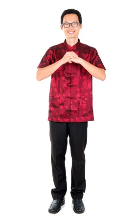 Happy Chinese new year. Asian man with gesture of congratulation Stock Photo - 17160915