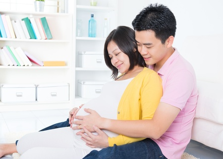 attractive pregnant: Asian couple. Husband and 8 months pregnant wife.