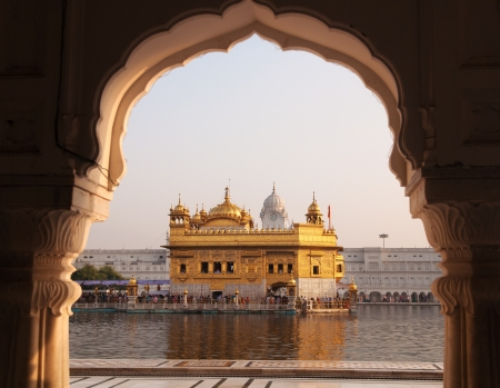sikh: Amritsar Golden Temple - India. Framed with windows from west side. focus on temple