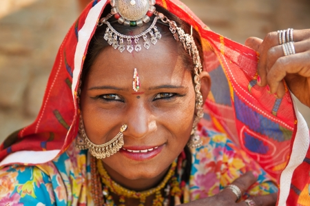indian village: Beautiful Traditional Indian woman in sari costume covered her head with veil, India