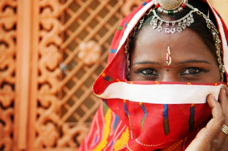 india people: Traditional Indian woman in sari costume covered her face with veil, India