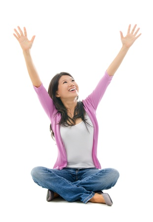 outstretched arms: Happy Southeast Asian Chinese woman arms opened looking up. Full body sitting on white background Stock Photo