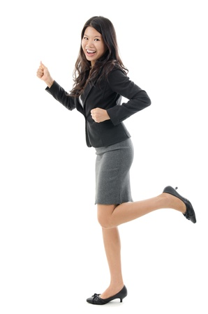 Business woman running. Business concept image with full body Southeast Asian Chinese businesswoman isolated on white background