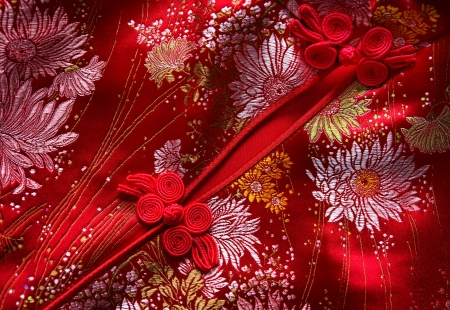 qipao: Traditional Chinese Red knot buttons on Cheongsam silk dress details