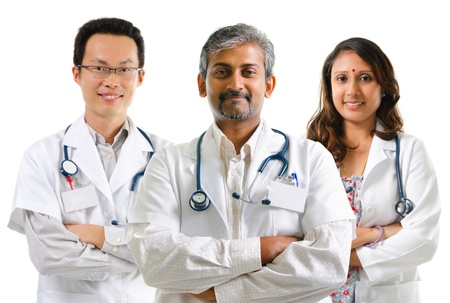 smiling doctor woman: Multiracial doctors  medical team crossed arms standing on white background Stock Photo