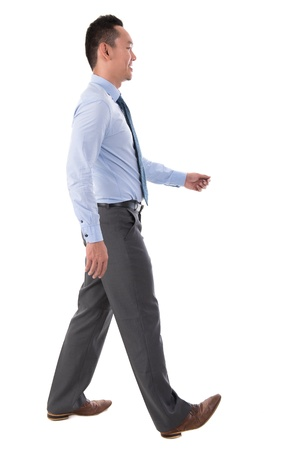 Side view full body Chinese Asian male walking looking forward isolated on white background photo