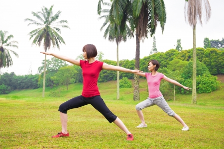 Asian girls practicing yoga outdoor green park photo