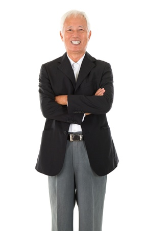 Cheerful Asian senior businessman standing isolated white background photo