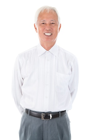 male senior adult: Confident Asian Chinese senior businessman standing isolated white background