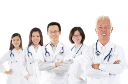 man doctor: Asian medical team, expertise senior and mature doctors leading young practitioners, standing isolated white background