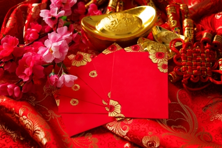 Chinese new year festival decorations , the chinese character on the gold ingots means fortune and luck photo