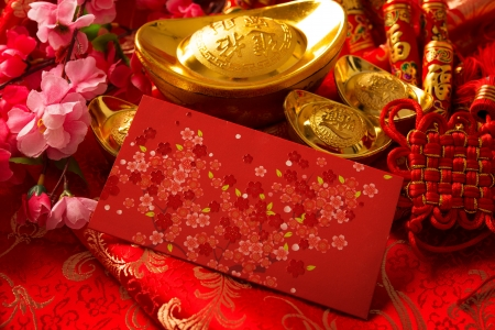 chinese festival: Chinese new year festival decorations, ang pow or red packet and gold ingots. Stock Photo