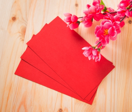 pow: Chinese new year festival decorations, blank red packet or ang pow ready for text.