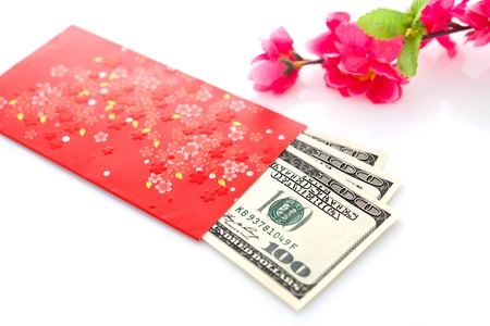 ang: Chinese new year festival decorations on white background, red packet or ang pow is given to children and elders during chinese new year for blessing. Stock Photo