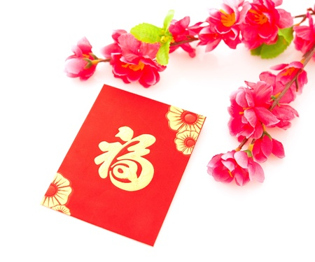 Chinese new year festival decorations on white background, the character on red packet or ang pow means prosperous.