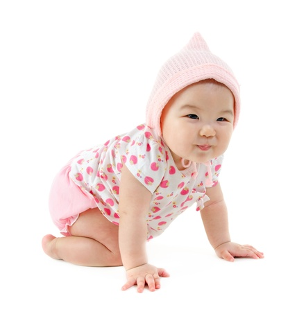 Full body Six months old East Asian baby girl crawling on white background photo