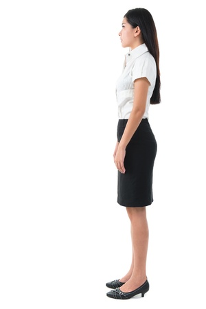 side job: Full body side view of beautiful Asian young woman standing on white background Stock Photo