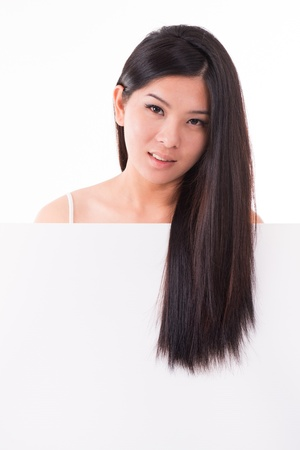 Asian girl with hair care concept, long black hair over white placard, isolated on white background Stock Photo - 17500972