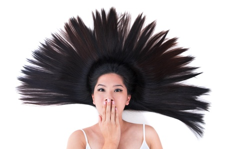 head shot: Beautiful young Asian girl lying on white with scatter hair